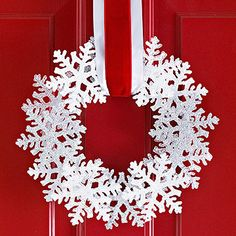 Snowflake Wreath - Pre-purchased ornaments & a flat foam wreath come together to make this easy snowflake craft. Remove string hangers from ornaments and position on wreath. Hot-glue snowflakes into place. Thread wide ribbon through wreath and hang. Snowflake Wreath, Christmas Snowflakes, Noel Christmas, Simple Christmas, Winter Christmas, All Things Christmas, Christmas Wreaths, Christmas Decorations, Christmas Ornaments