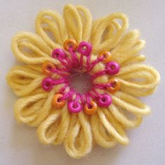 flower loom with beading- okay, not crocheted, but neither are the rare knitted flowers here........... ???