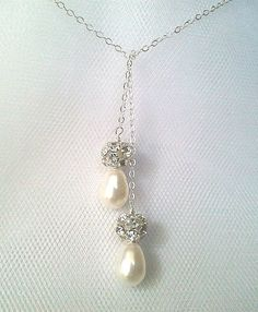 Weddings Jewelry White Pearl Collection - Wedding Gift, Bridal Jewelry, Swarovski Dangle Wedding Elegant Handmade Jewelry    Classic Swarovski pearls...with glamorous Rhinestone accents!  --Available in ANY pearl color - just ask!--  This design has been made with CRYSTALLIZED™ - Swarovski Elements.    -Necklace made with 8mm pearls and glam silver rhinestone balls. Beautiful lariat necklace. It measures 20in before tie.  (If you require a different length, please specify in shopping cart.)…