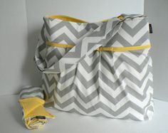 Monterey Bag Large Diaper Bag Set - In Grey Chevron and Yellow - Adjustable Strap and Elastic Pockets. $105.00, via Etsy.  This is adorable but I don't think Philip would carry it, although it's not as girly as some.  As for just a purse, it's a little expensive at $105.