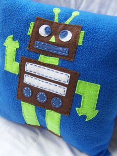 Tot Bot Pillow, Felt Robot Pillow. $25.00, via Etsy...or I could just make it.  :o)