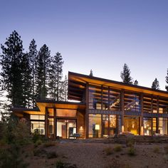 A modern mountain aesthetic delineates the design of this home located along the putting course. The design features a mix of stone, steel and timber elements that are punctuated with large window walls that fill the home with natural light. The plan is organized with an open flowing great