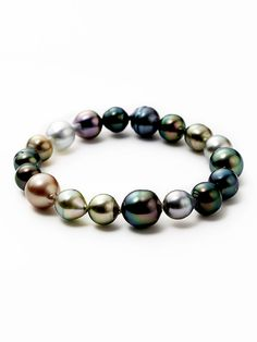 Tara Pearls Multicolor Tahitian Pearl Stretch Bracelet 8 x natural multicolor Tahitian cultured pearl stretch bracelet No closure Measurements: in diameter, wide Material: Pearl and elastic Brand: Tara Pearls Origin: Imported Pearl Jewelry, Beaded Jewelry, Jewelry Box, Jewelery, Jewelry Accessories, Fine Jewelry, Jewelry Making, Beaded Bracelets, Diamond Jewelry