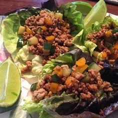 Asian Pork Lettuce Wraps  Absolutely delicious!!! SERVES 4 2 T avocado oil 3 cloves garlic minced 1 1- inch piece fresh ginger grated 1 small orange bell pepper chopped 1 lb. ground pork 1/2 cucumber chopped 2 T hoisin sauce 1 T rice vinegar or distilled white vinegar salt & pepper 1 cup chopped cilantro 12 large Boston or butter lettuce leaves lime wedges for serving 1. In a large skillet heat oil over medium-high heat. Add garlic ginger bell pepper and pork. Cook stirring occasionally…