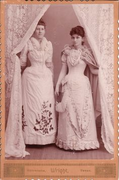 Whilst researching curtain ideas today (I'm making some for my room), I came across this little diddy. I love it!! I don't know what stands out most: the randomness of staring from behind a curtain, the abundance of white lace, or the fact that their dresses have hip bustles. HIP BUSTLES!