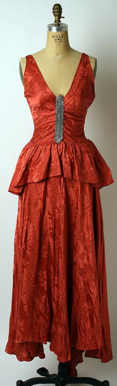 Dress, Evening  House of Lanvin  (French, founded 1889)    Designer:      Jeanne Lanvin (French, 1867–1946)  Date:      spring/summer 1930  Culture:      French  Medium:      silk  Dimensions:      Length at CB: 68 1/2 in. (174 cm)  Credit Line:      Gift of Miss Frances McFadden, 1950  Accession Number:      C.I.50.84.1