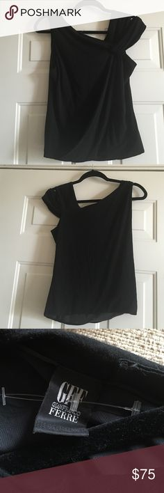Gian Franco ferre designer black top. Small Beautiful sexy one shoulder look but it is not one shoulder. Asymmetric neck line. Great condition. It has a liner. Original over $300 . Gianfranco Ferre Tops Tank Tops