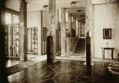 Stoclet Palace, Brussels, by Josef Hoffmann. Built-in collector cases, at left, contain antiquities.