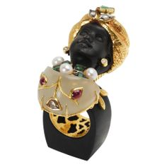 Lotus Arts de Vivre Carved Wood  Gem-Set Muro Ring Hand-carved, black wood Muro ring with gold-plated silver turban, pear-shaped jade, kundan-set rubies, bezel-set diamonds, and button pearls. Rubies weighing 0.49 total carats and diamonds weighing 0.39 total carats. Handcrafted in Thailand. Price: EUR 5,985.25