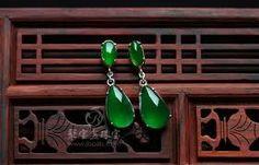 A pair of imperial green jadeite earrings