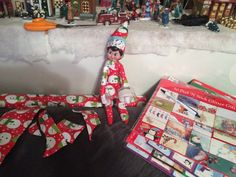 Day 15 - Candy wrapped herself up like a present. She even put a label on her hat to the family. Elf on the self