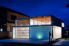 yoshiaki yamashita places transparent garage at the center of a kyoto home
