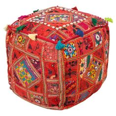 Featuring an exotic patchwork design and tassel accents, this handmade cotton pouf brims with eye-catching style for your home.   Produc...