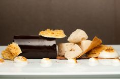 Milk Chocolate Mousse with Dehydrated White Chocolate Mousse, Frozen Graham Cracker Foam, and Passionfruit Marshmallow