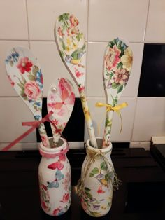 Simple glass milk bottle and wooden spoon painted and decoupage