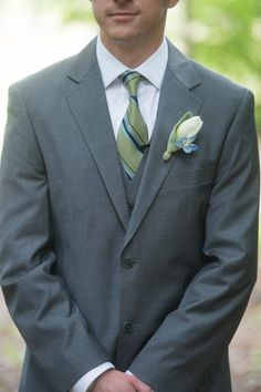 Gray suit with green and blue tie for groomsmen attire. M. Elizabeth Events