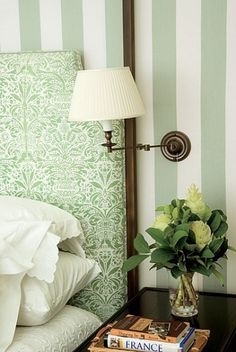 .Love the restful soft green of the headboard -- not so sure about the striped wallpaper which looks a little too hotel-ly to me. Pale powder paint by Farrow and Ball instead....