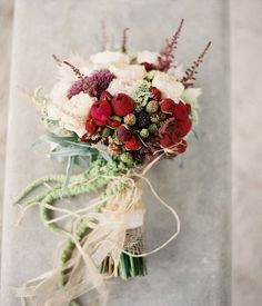 White and red rustic bouquet for winter wedding, asymmetrical