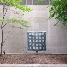 "Heidi Parkes with her quilt, ""Ocean"" outside the Museum of Contemporary Art in Chicago. #quilt #handquilting #grid"