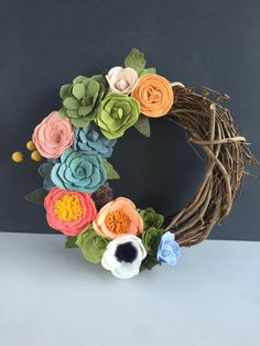 This wreath is a perfectly sweet little size to adorn a nursery wall, group with other wall hangings in a gallery wall, or rest on a mantle. Each one is handmade and can be created in any color scheme and with any combination of blooms. Yours will be uniquely yours as no two are ever exactly alike! Please note that due to the nature of grapevine wreaths, size may vary slightly. Flower volume will stay consistent, no matter the exact size or shape of the wreath itself.
