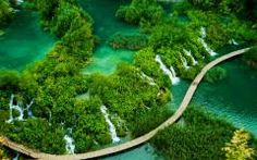 Plitvice Lakes, Croatia. Your path is that wooden walkway and it seems to go on forever.  <3
