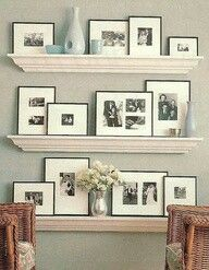 above the fireplace?  1 level with family pics  great idea!