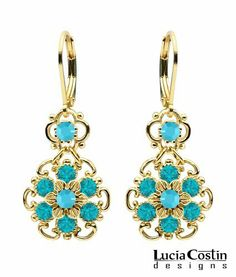 Lucia Costin Dangle Flower Earrings Made of 24K Yellow Gold Plated over .925 Sterling Silver with Twisted Line Accents, Turquoise - Green Swarovski Crystals; Handmade in USA Lucia Costin. $54.00. Unique and feminine, perfect to wear for special occasions and evenings. Produced delicately by hand, made in USA. Feminine floral design. Beautifully designed with blue - green, turquoise Swarovski crystals. Lucia Costin dangle earrings