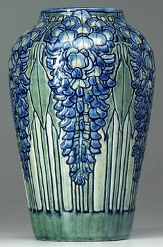 NEWCOMB COLLEGE Exceptional and early vase carved and painted by Marie De Hoa LeBlanc with blue wisteria and green le. on Mar 2008 Antique Pottery, Pottery Plates, Pottery Vase, Handmade Pottery, Antique Art, Ceramic Pottery, Slab Pottery, Handmade Ceramic, Kintsugi