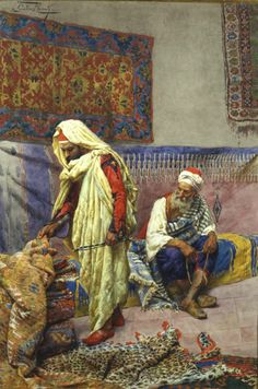 GIULIO ROSATI (1858-1917) 'At the Carpet Merchant'