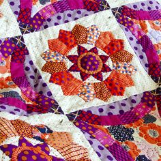 The exquisite Fanciful Quilt is the perfect project for everyone who loves Dresden Plate quilts. Flower-centered Dresden Plate blocks , combine with Double Wedding Ring blocks are set on point and finished with a beautiful scallop border.