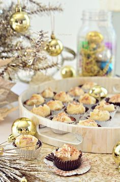 Enjoy the sinful decadence of eggnog one bite at a time with these easy Eggnog Truffles in Chocolate Cups. Recipe at TidyMom.net