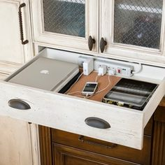 clever!! Organized: A place for everything (including iDevices.) Kitchen drawer charging station.