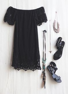 black scalloped dress and accessories