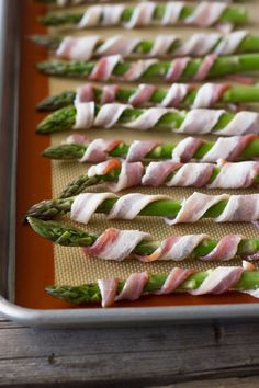 Bacon Wrapped Asparagus This is a delicious and easy way to serve asparagus. I love asparagus and this is an amazingly delicious way to to jazz it up