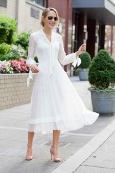 white lace dress with strappy sandals