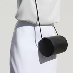 curated by minimalism.co — little bucket bag. minimal, minimalist, accessory, handbag