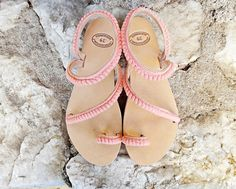 A very stylish handmade leather stripe sandal made with high quality Greek leather in natural tan color adorned with cotton pom pom lace in salmon. Pom