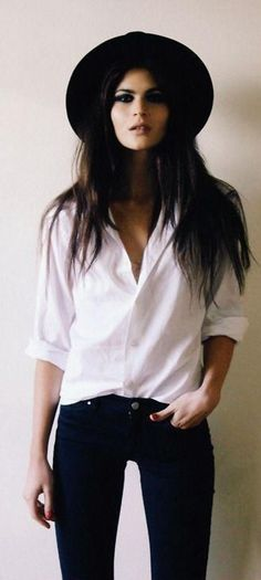 love the absolutely simple and casual look. white chiffon shirt, black hat, deep blue jeans.