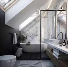 There is great scale in this bathroom because the windows add light into the room and the placement of the counter and toilet add balance.
