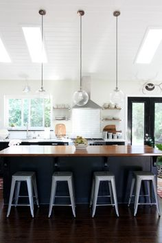House Tweaking, Dana Miller's Kitchen, Ikea Black Kitchen Cabinets, Tolix Stools | Remodelista