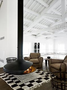 A Renovation in Umbria by Paola Navone. (via A Renovation in Umbria by Paola Navone Suspended Fireplace, Hanging Fireplace, Freestanding Fireplace, Floating Fireplace, Cozy Fireplace, Warehouse Renovation, Loft Industrial, Industrial Design, Vintage Industrial