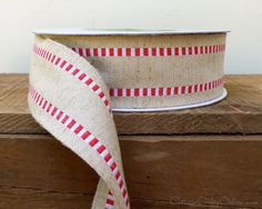 """Cotton burlap ribbon with a white and red stripe, 1 1/2"""" wide, with a lightly wired edge.  A softer feel and closer weave than jute burlap and the snappy checked stripe makes it more refined while still having the look and style of burlap or linen. * * * Available from the Cottage Crafts Online shop on Etsy, a world of ribbons and craft supplies."""