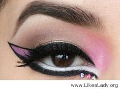 Pink cat-eye and rhinestones eye makeup