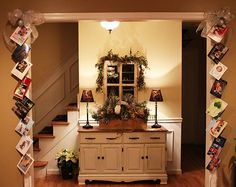 Hang your cards on ribbon to frame a doorway. I might use glittery clothes pins.