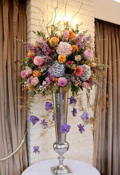 colourful silver vase display Centrepieces, Table Centerpieces, Bury St Edmunds, Tudor Rose, Tall Vases, Urn, Floral Arrangements, Floral Wreath, Gardens