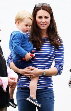 Kate Middleton in a blue striped shirt and blue jeans