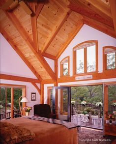 Timber frame bedroom with its own patio access.