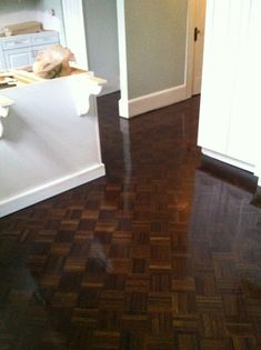 Beautifully refinished parquet flooring, I recommend Champion for refinishing the floors.