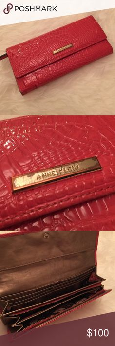 Anne Klein Wallet Gentle use. Very little signs of wear other then on the gold plate logo. It's a beautiful fun coral color and has so much use left! Really not trying to sell this piece. I use it with my LV Speedy 35 often! Anne Klein Bags Wallets