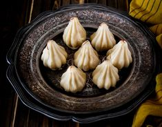 Celebrate the festive season with some Unique Modak Recipes for Ganesh Chathurthi - for the family to enjoy and to gift friends and relatives as well! Indian Dessert Recipes, Indian Sweets, Modak Recipe, Cupcake Decorating Tips, Vegan Recipes, Cooking Recipes, Caramel Flavoring, Indian Paintings, Abstract Paintings